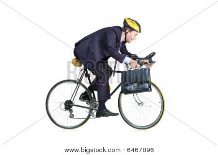 Businessman in a suit with riding a bicycle