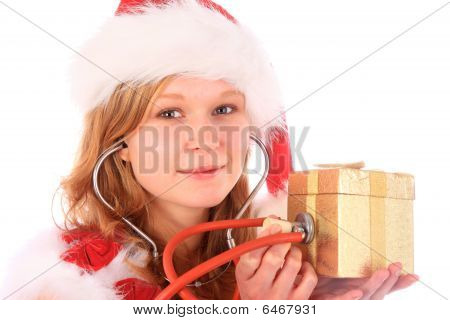 Miss Santa Is Giving A Smile While Sounding A Golden Gift Box