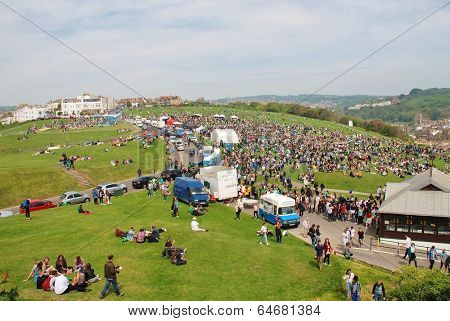 HASTINGS, ENGLAND - MAY 5, 2014: Crowds gather on the West Hill at the annual Jack In The Green festival. The traditional festival marks the May Day public holiday in Britain.
