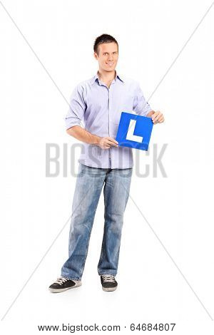 Full length portrait of a young man holding an l sign isolated on white background