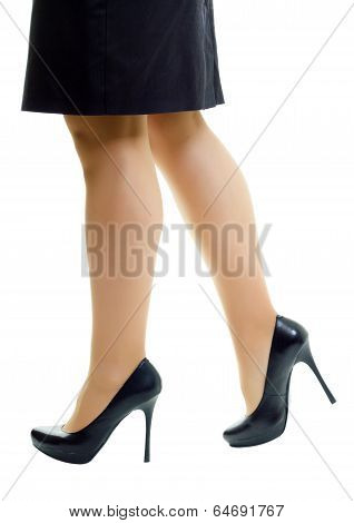Female Legs In Skirt And High Heels. Isolated