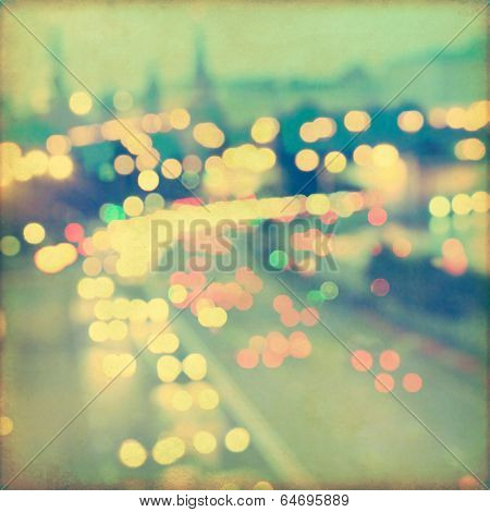 Abstract blurred cityscape background with bokeh effect. Grunge and retro style.