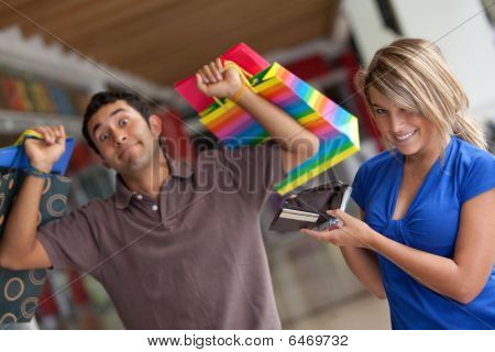 Shopping Woman Emptying A Wallet