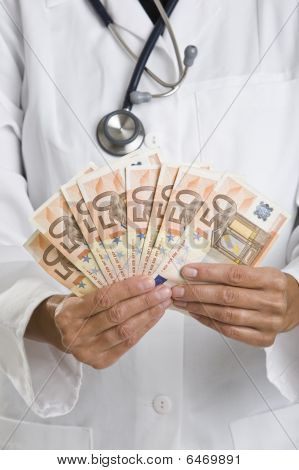Female Doctor Holding Money