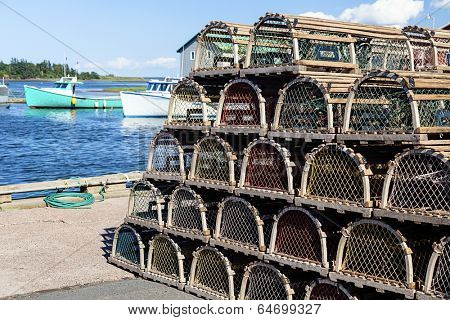 Piles of lobster traps on the wharf in rural Prince Edward Island, Canada.