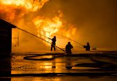 stock photo of fireman  - Firemen at work on fire - JPG