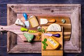 stock photo of penicillium  - English and French cheese on wooden boards knives for cheese - JPG
