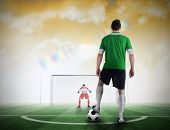 pic of football pitch  - Composite image of football player about to take a penalty against football pitch under yellow sky - JPG