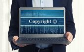 image of plagiarism  - Copyright message on laptop screen close up - JPG