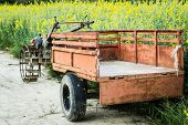 foto of tractor-trailer  - tractor with old trailer on a field - JPG
