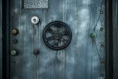 stock photo of vault  - Grunge style image of old metal door background with vault lock - JPG