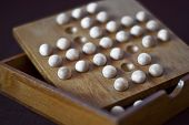 stock photo of brain-teaser  - Detail of wooden brain teaser - JPG