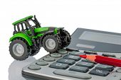 pic of tariff  - a tractor and a red pen is on a calculator - JPG