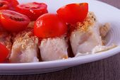 foto of hake  - Hake au gratin with tomatoes over white plate - JPG