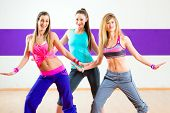 stock photo of dancing  - Young women dancing modern group choreography in dance school - JPG