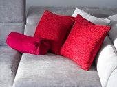 picture of puffy  - Throw pillows on couch isolated on white - JPG