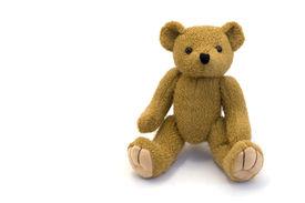 image of stuffed animals  - Cute little brown plush teddy bear sitting - JPG