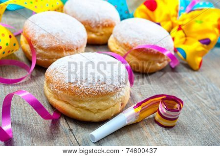 Krapfen or donuts with jam and icing sugar