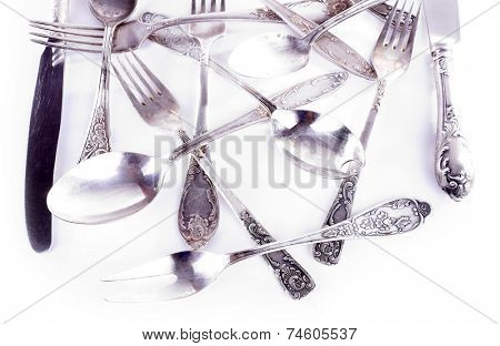 Disordered tableware isolated on white