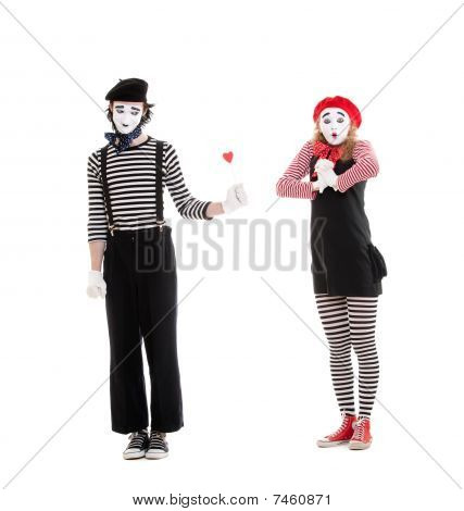 Man Giving Small Red Heart To Amazed Woman