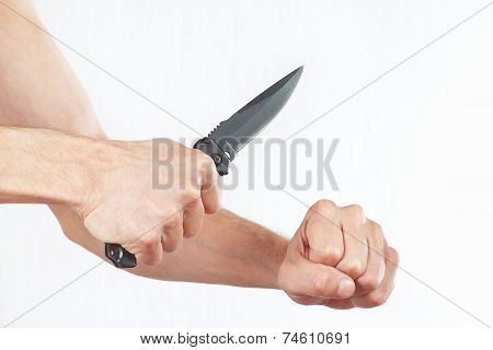 Hand position to attack with a knife on white background