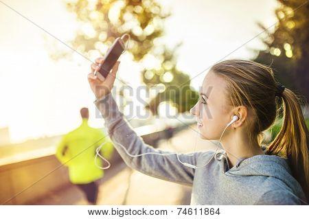 Female runner taking selfie