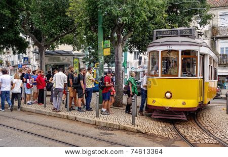 People Waiting At The Tram Stop.