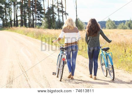 Two friends during their bike walking outdoors