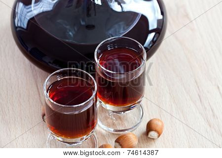 Hazelnut Liqueur In Two Glasses With Hazelnuts