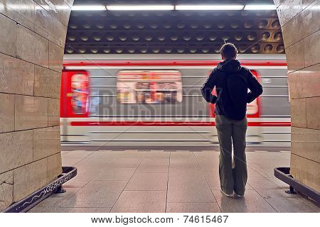 Young Woman Waiting For The Subway Train