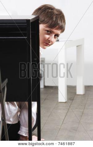 Businesswoman Hiding Behind Desk