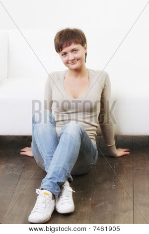 Smiling Woman In Casual Sitting On Floor
