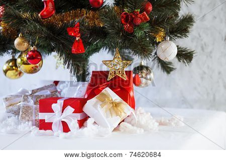 Christmas presents boxes under the fir tree