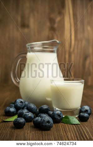 Milk In Glass Jug And Blueberries