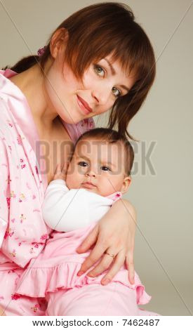 Mom Holding Baby Girl In Hands