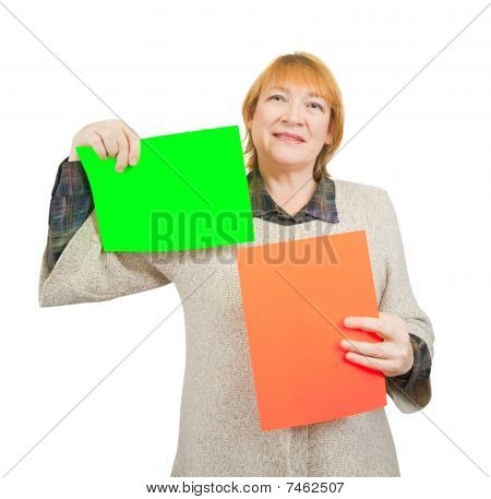 Senior Woman Holding Green And Red Posters.