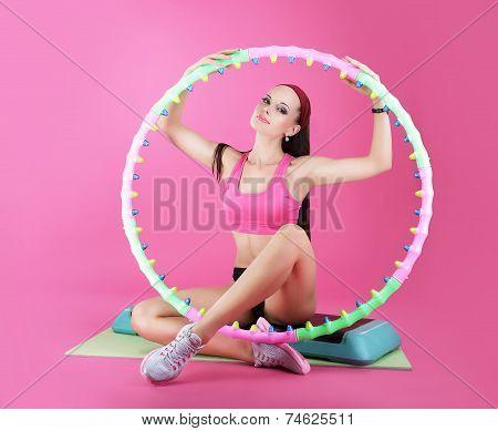 Wellness. Sport Club. Woman Sitting With Sport Equipment