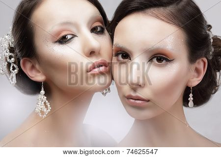 Glamour. Portrait Of Two Women With Shiny Glossy Makeup
