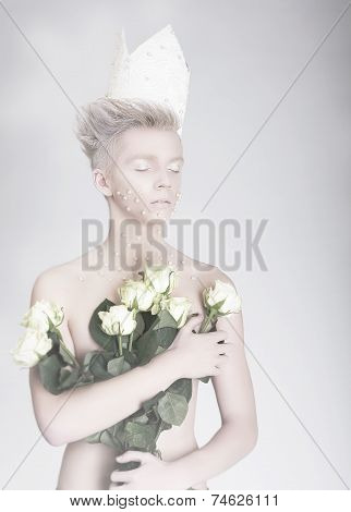 Artistry. Trendy Young Man In Paper Crown With Flowers
