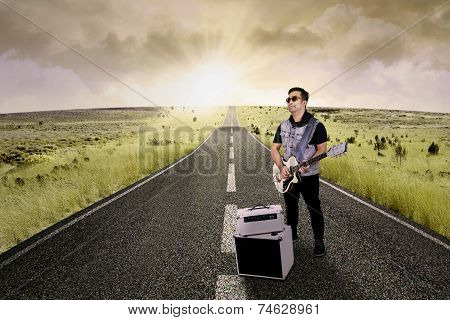 Guitarist Playing Guitar On The Road