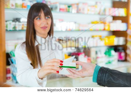 Pharmacist suggesting medical drug to buyer in pharmacy drugstore, selective focus