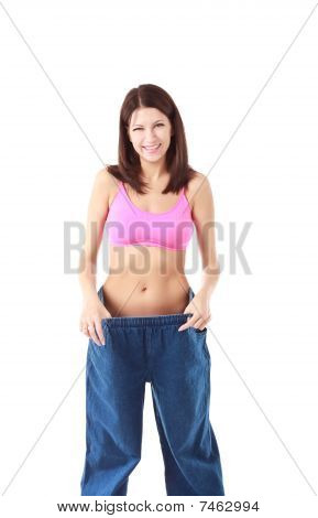 Woman Showing How Much Weight She Lost