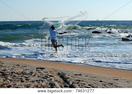 Man Throwing Casting Net