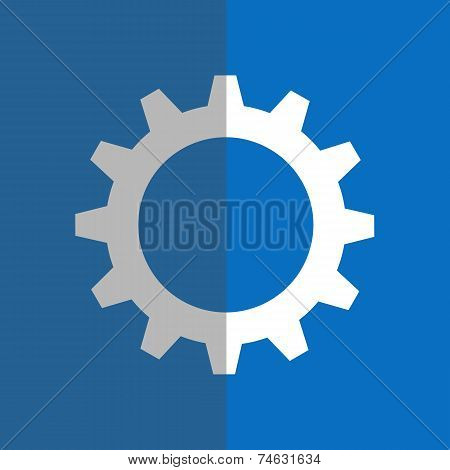 White gearwheel on blue background