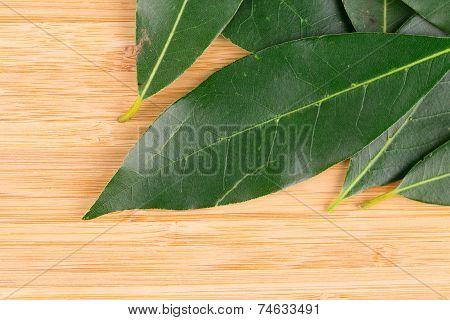 Bay leaves on a cutting board.