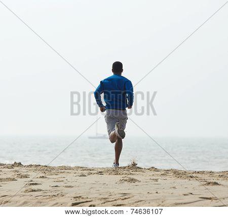 Rear View African American Man Jogging