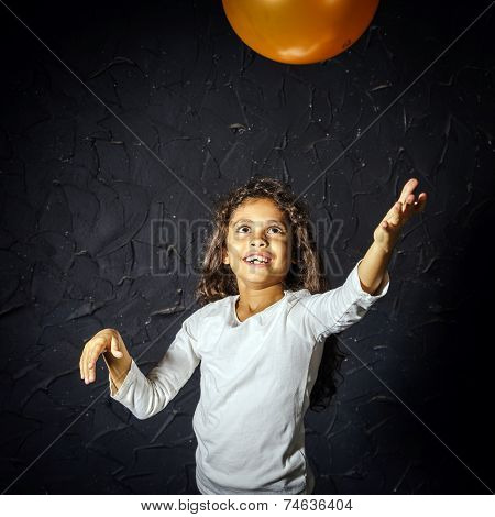 Cute Little African-american Girl Plaing With Balloon
