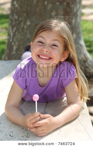 Girl holding lollipop