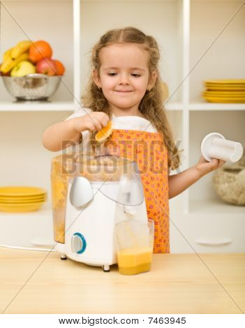 Little Girl Making Fruit Juice