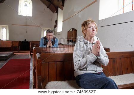 Two People Praying